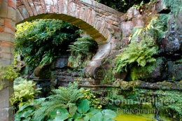 A stone arch decorates the garden