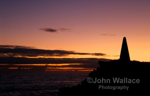 The sun sets across the Obelisk in Robe at Cape Dombey, South Australia. Built in 1852 given the coasts notoriety for ship wrecks the Obelisk was used to store rockets which were fired to distressed ships. The rockets carried lifelines and baskets for bringing passengers ashore.