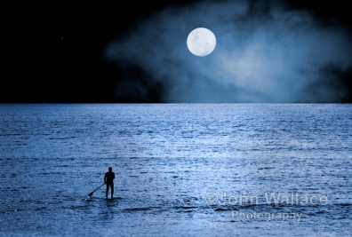 The last paddle boarder of the day heads home alone