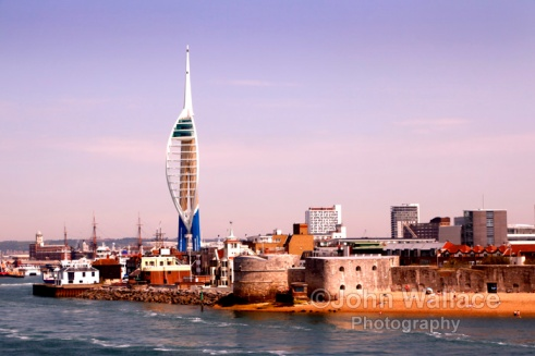 The entrance to Portsmouth Harbour in England. Harbour defences are in the foreground whilst the 560 foot Spinaker Tower rears above the harbour.