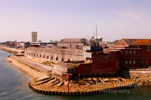 The entrance to Portsmouth Harbour in England. Harbour defences are in the foreground on the Gosport side of the harbour.
