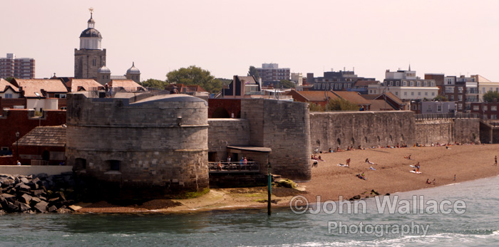 The entrance to Portsmouth Harbour in England. Harbour defences are in the foreground.