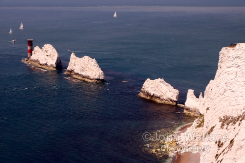 The Needles is a row of three stacks of chalk that rise 30m out of the sea off the western end of the Isle of Wight in the Solent, England, United Kingdom