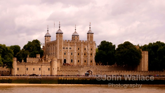 The beauty of historical workmanship of the Tower of London UK as seen across the river Thames