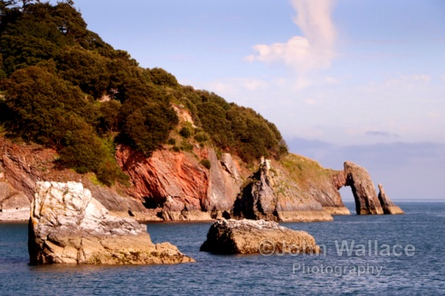 A natural arch formed by the waves in the cliffs at Torquay in Devon, England