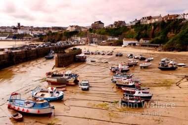 Low tide at the small harbour in Newquay, Cornwall, England, UK