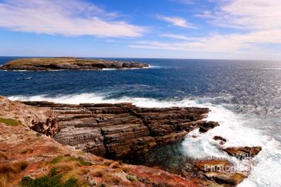 A jagged rocky coastline off the coast of Kangaroo Island, South Australia, the background islands are 'The Brothers' (Casuarina Islets).